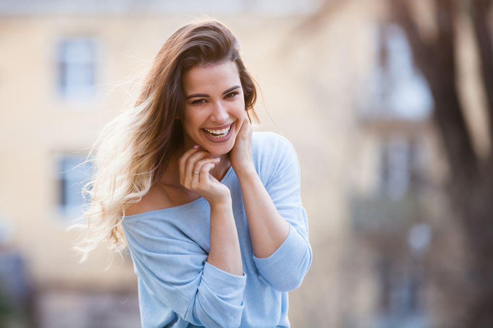 woman happy following dermapen treatment in Preston
